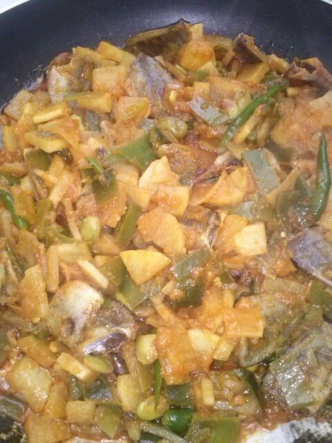Shutki bazi with bangladeshi vegtables uri and mula, with scotch bonnet chillis ,its hot and spicy and delicious