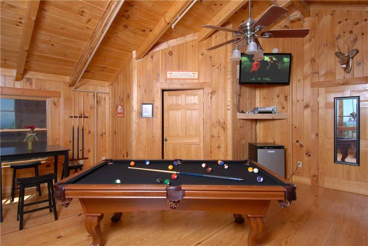 "View Topia Falls -- The top level has a queen bed with top of the range mattress, leather queen sofa sleeper, regulation size pool table, 46""Flat Screen LCD HD TV with X Box 360, iPod home stereo/charging station, arcade game and pub table with 4 saddle stools."