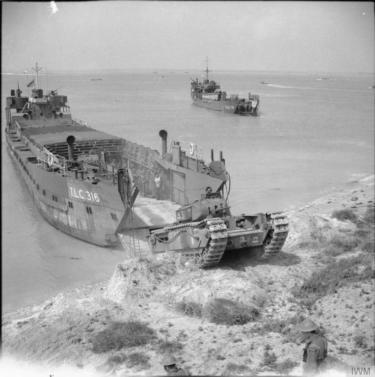 A Churchill tank, 'Talisman' of 3rd Troop, 'A' Squadron, 48th Battalion Royal Tank Regiment, leaves a tank landing craft (TLC 316) during a combined operations exercise at Thorness Bay on the Isle of Wight, 27th May 1942
