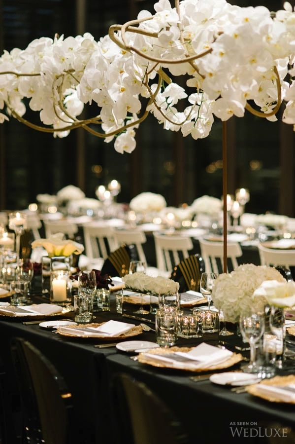 #Floral arrangement suspended above the head table.  | Photography by Tara McMullen Photography | WedLuxe Magazine