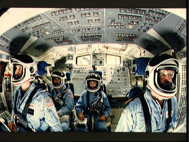 A picture of the Space Shuttle Challenger crew in launch positions in the shuttle simulator.