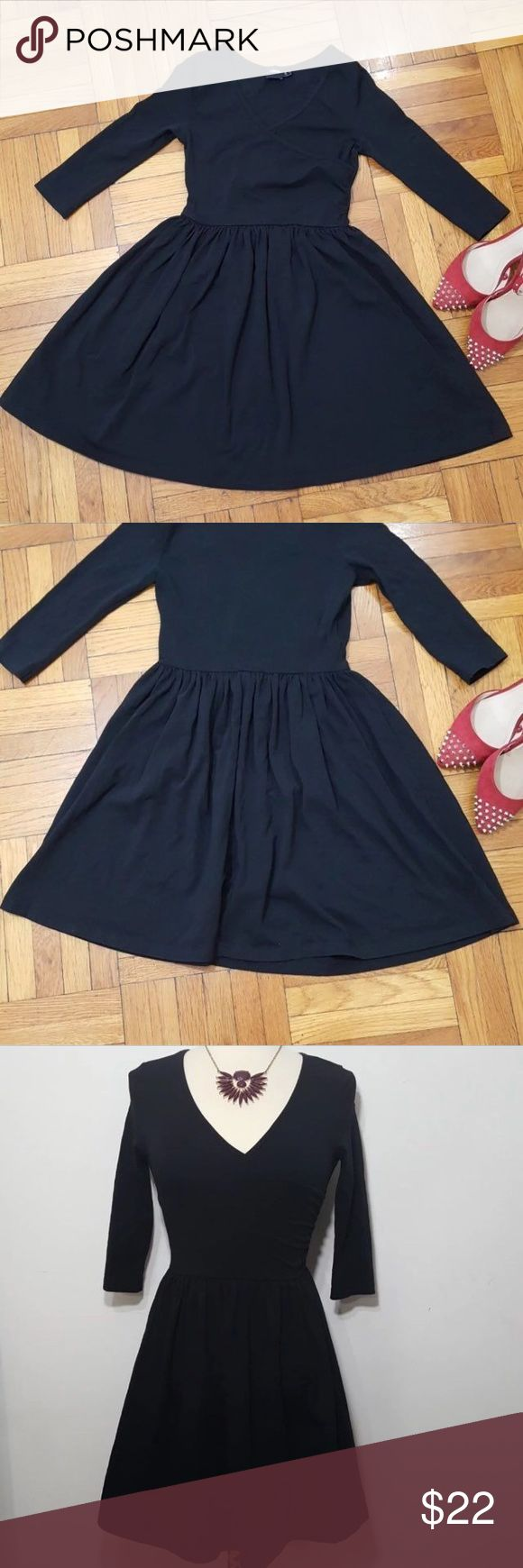 NWOT black asos skater dress -size 2 -ASOS  -3/4 sleeves  -all black -faux wrap around neckline -worn once for a photo shoot  -no rips or stains -NWOT -slight stretch -super soft fabric NO TRADES  firm price unless bundled SAME day shipping - buyer will be notified if item can't be shipped the same day ASOS Dresses Mini