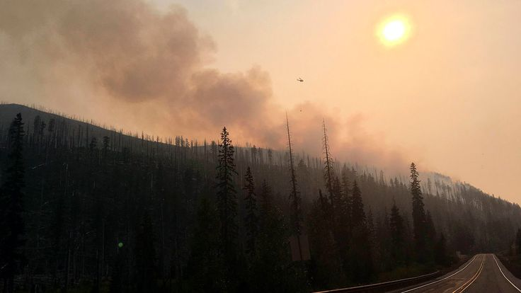 FOX NEWS: Irritating smoke from wildfires choking US West turning lives upside down The smoke from massive wildfires hangs like fog over large parts of the U.S. West an irritating haze causing health concerns forcing sports teams to change schedules and disrupting life from Seattle to tiny Seeley Lake Montana.