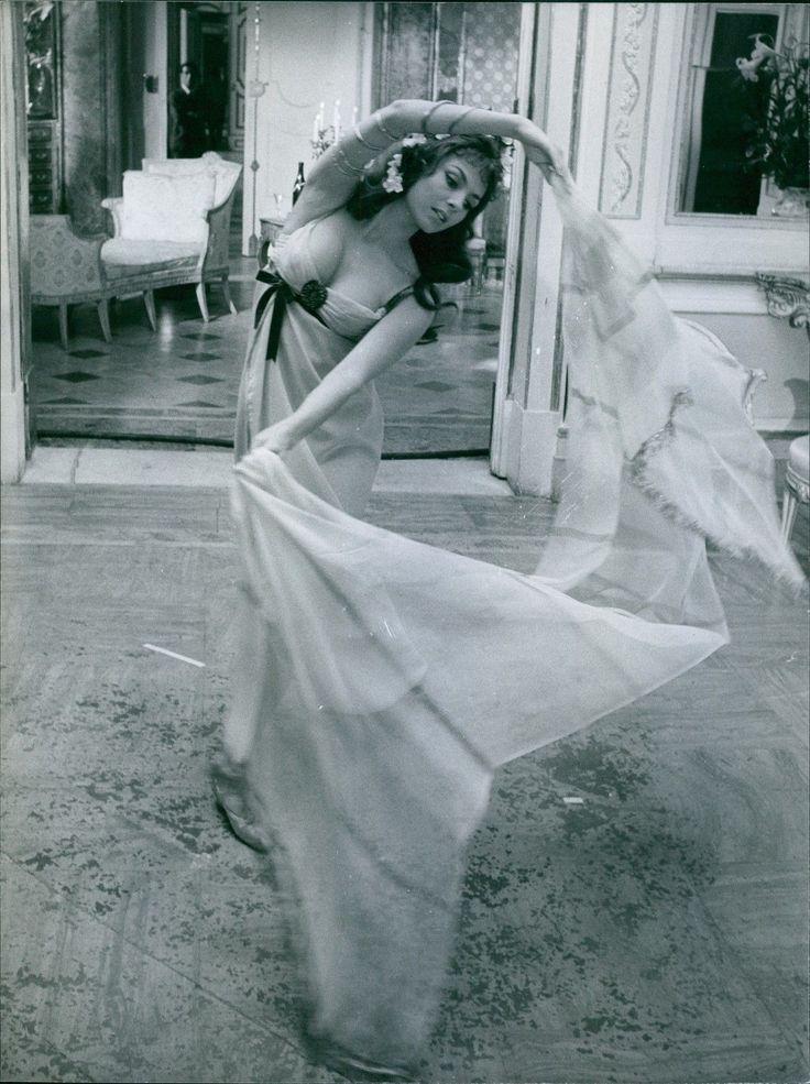 Vintage Photo of Michele Mercier Spreading A Piece of Cloth | eBay