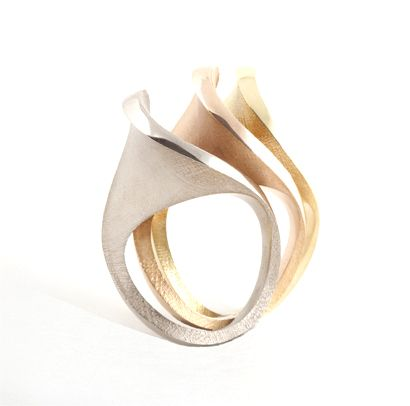 Sarah Herriot. Spooning rings, shown here in white, red and yellow 18ct