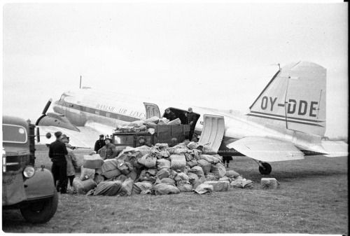 A aircraft (named Erik Viking) from Danish Air Lines is loaded with mail bags at Beldringe Airport, Odense Denmark. February 3 1947 Source: http://imgur.com/P0HMWH6