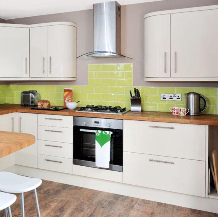 Cream cupboards and oak worktop