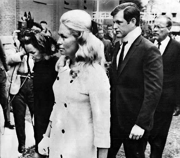 Kennedy & wife, Joan, for the funeral of Mary Jo Kopechne on July 22, 1969. Accompanying them was Ethel Kennedy, left, the widow of RFK. On July 18th, Kennedy had thrown a party in Chappaquiddick, Mass., near Martha's Vineyard, for staffers from RFK's 1968 presidential campaign. According to an account given by Kennedy, he was driving Kopechne to the ferry to Martha's Vineyard early the next morning when he took a wrong turn & drove his car off a wooden bridge. He left for help. Kopechne…