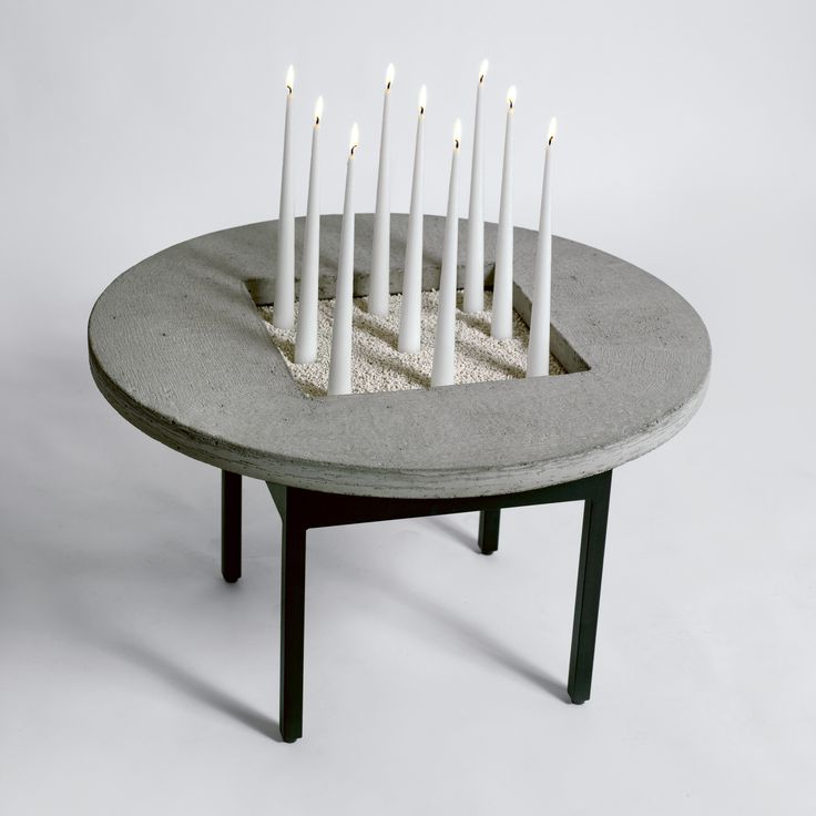 CONCRETE JUNGLE 2007 Jonas Bohlin H 40 cm, 65 Ø cm Table. Lacquered steel frame, table top in concrete, including 25 handmade candles and aquarium gravel. Limited edition of 100 pcs, numbered and signed.