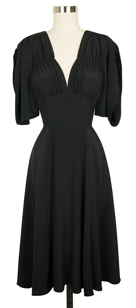 The new Trashy Diva Kimono 40's Dress in Black Rayon has the familiar silhoulette of the 1940s Dress with draping sleeves!