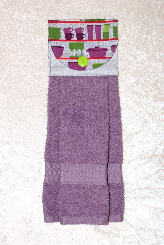 I adore this handmade purple and lime hanging hand towel. Purple kitchen textiles are so hard to find. The retro dishes are the best!