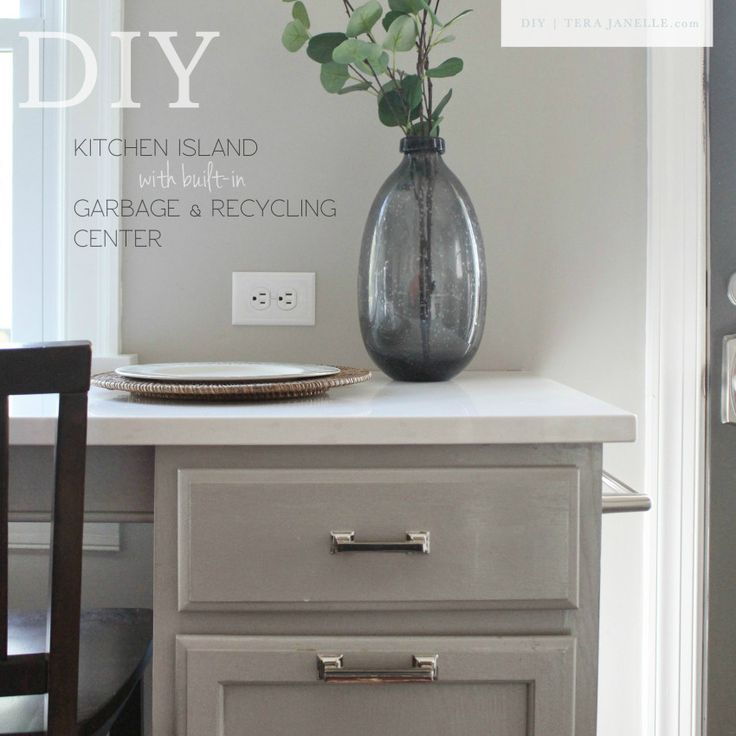 Classic Gray & Marble Kitchen.  DIY furniture-style kitchen island or peninsula with built-in pull-out garbage & recycling center.  Plus tricks for installing a kitchen counter in front of a window.