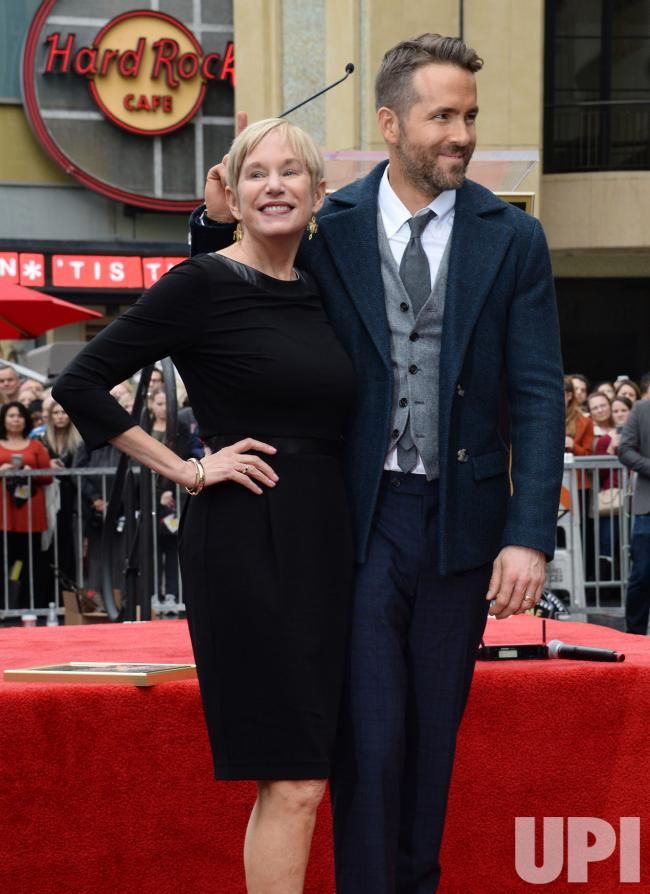 Actor Ryan Reynolds is joined by his mother Tammy Reynolds during an unveiling ceremony honoring Reynolds with the 2,596th star on the…