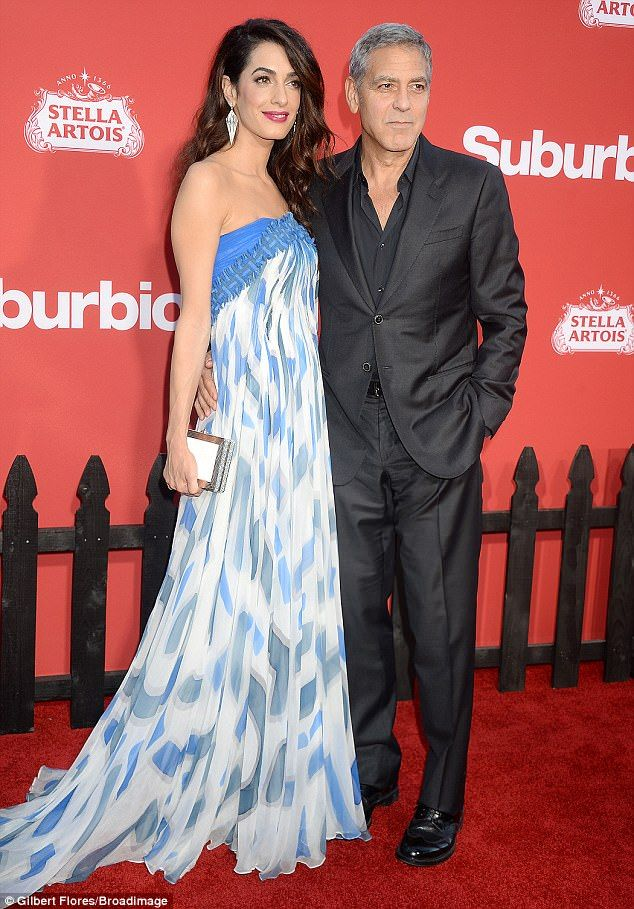 Promoting his movie: George Clooney was the man of the hour at the premiere of his new film Suburbicon in Los Angeles on Sunday and he brought along wife Amal to the red carpet event