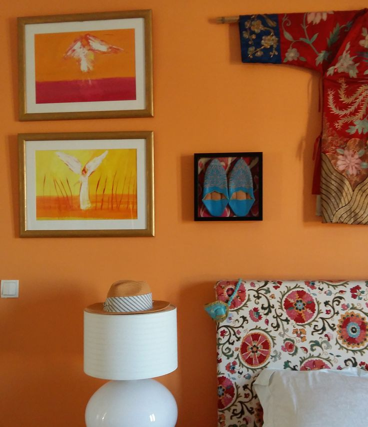 the bedroom - orange walls, paintings, babouches, chinese robe