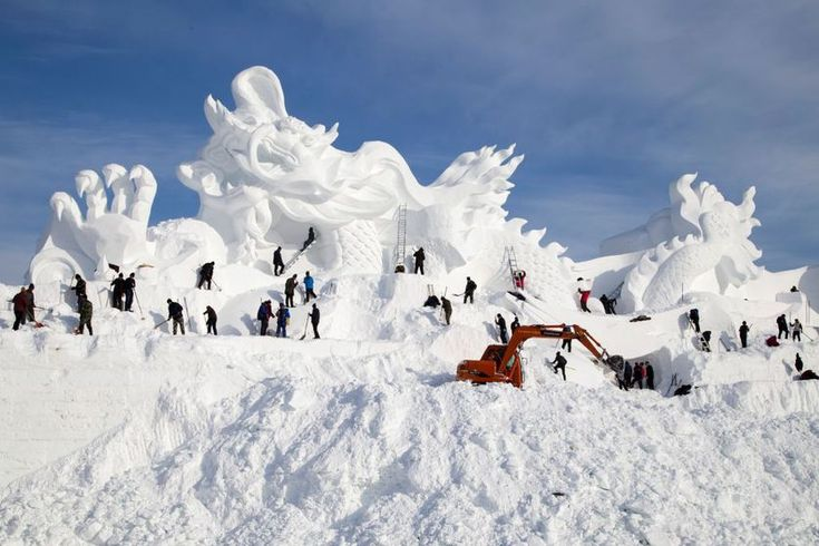 Artists work on the construction site of a 262-foot snow sculpture for the Vasaloppet China ski festival in Changchun in China's northeastern Jilin province.