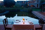 Candle night dinner by the pool in Bangalore resort