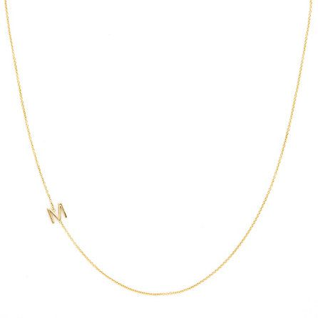 An understated way to wear a monogram. Asymmetrical Mini Letter Necklace - M