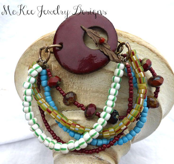 Dark red Ceramic, Indonesian glass and  metal Multi strand bracelet.