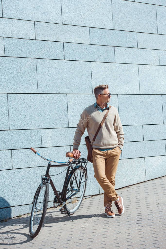 Stylish Middle Aged Man Sunglasses Leaning Bicycle Looking Away