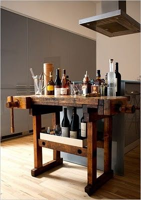 rustic workbench turned into storage and texture to a modern kitchen, vice grips still attached