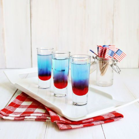 Your favorite patriotic popsicle as a kid, in alcohol-form. This shot gets its bright colors from grenadine, Mike's Hard Lemonade, and blue curaçao.  Get the recipe at A Beautiful Mess.