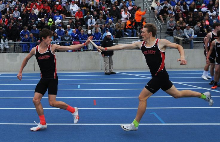 Gilbert's Will Greder and Rees Tyler exchange the baton during the Cclass 3A 4x800-meter relay on Thursday at the state track and field meet at Drake Stadium in Des Moines. Photo by Nirmalendu Majumdar/Ames Tribune http://www.amestrib.com/sports/20170518/prep-track-and-field-gilbert-girls-win-4x800