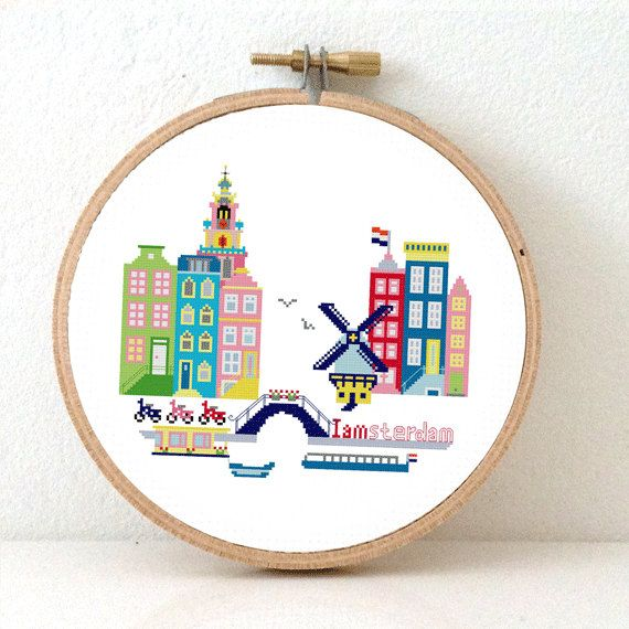 Sunny Modern Amsterdam Modern Cross Stitch Pattern. Use this Amsterdam Cityscape pattern to make a colorful decoration for a nursery room or cute DIY gift for an Amsterdam lover. Design by Studio Koekoek