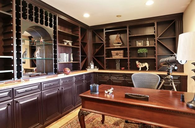 The library has built-in bookshelves and recessed lighting. Photo: Liz Rusby, The Grubb Co.