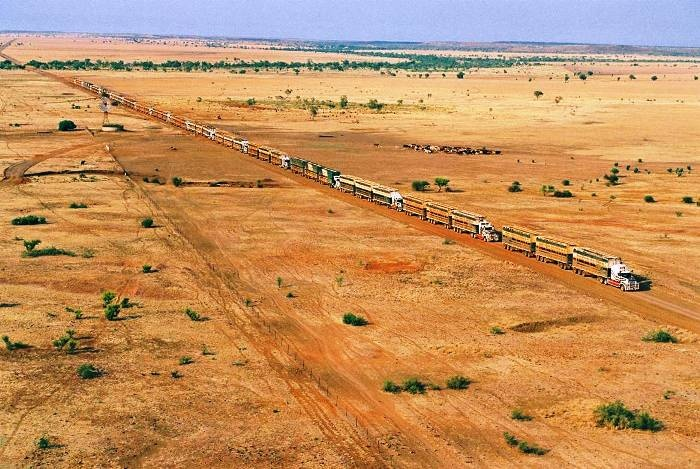 """""""trucking australian style"""" - The odd one or two road trains in that line up. Great photograph."""