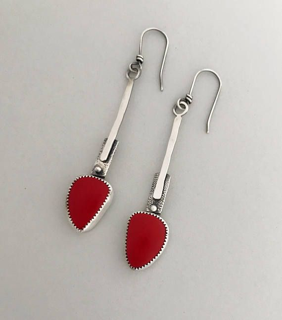 A pair of Rosarita Red gemstones that I set in sterling. They are beautiful as drop earrings and can be easily be dress up or down. Please read more about Rosarita below.  All my ear wires are sterling silver and handmade by me.  Rosarita Red gemstone 15 carats. The length of these earrings from the top of the ear wire are 2.8  The width at the widest point is .5  Sterling silver setting.  My signature and .925 are on the piece.  All my pieces are 100% handmade by me.  Thanks for stopping…