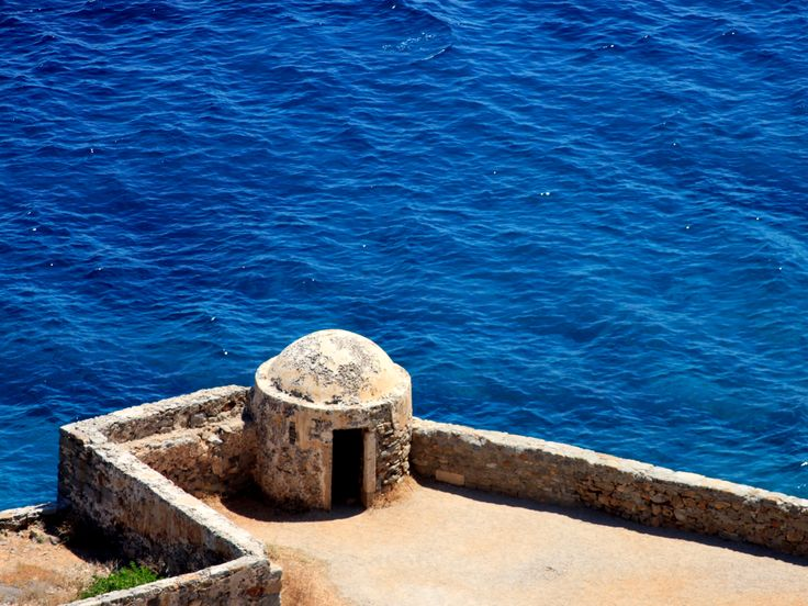 "Spinalonga. She played with the word rolling it around her tongue like an olive stone. The island lay directly ahead and as the boat approached the great Venetian fortification which fronted the sea […]. This, she speculated, might be a place where history was still warm, not stone cold, where the inhabitants were really not mythical"" Victoria Hislop in her best-selling book The Island"
