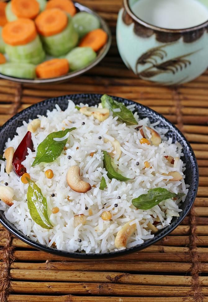 Coconut rice recipe with step by step photos. One of South Indian's favorite rice dishes that is made often for quick lunch or lunch box or festive meals