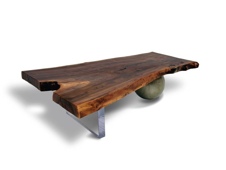 """Walnut Coffee Table - Plexi & Metal    Contemporary coffee table made of a salvaged live edge Claro Walnut slab. The organic shaped walnut slab has natural edges and a fine polished surface, finished with natural oil. With the combination of a lucite base and a steel sphere base finished in aged silver patina, this unique accent table is a great conversation piece.    Customization options include finishes, reclaimed wood types, sizes, and base materials.    Dimensions: 53""""L x 24"""" to 36""""D x…"""
