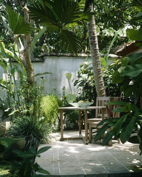 Patio, secluded, lush green foliage, outdoor dining