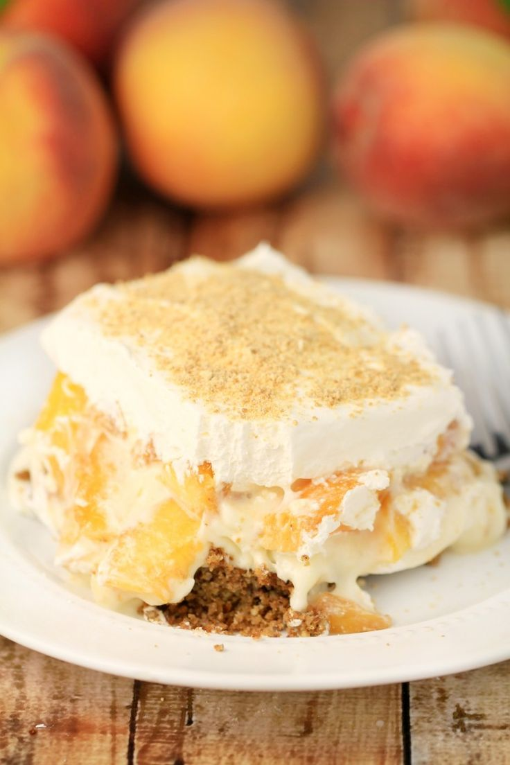 Luscious layers of pecan, cheesecake, fresh peaches and finished with a layer of whipped topping - Peach Delight with Pecan Crust is a delicious summer dessert recipe.