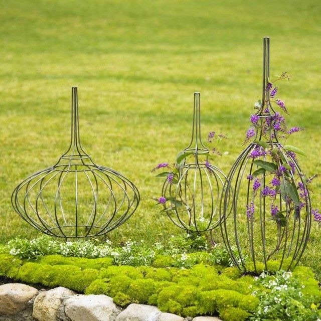 These metal topiary frames have a function - to support and give form to vining plants.   But here set in a garden bed they also work as interesting sculpture.   If you need some interest added to your MN landscape, visit us at http://www.aldmn.com