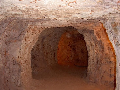 """Coober Pedy is an opal mining town located in the harsh Outback of South Australia, Australia, some 850 kilometres north of Adelaide and 690 kilometres south of Alice Springs.    """"Coober Pedy - the town where people live underground, and famous for its opals to be sure. But some of the other real beauty of this extremely hot, remote outback area is best seen from a stool in the front bar of the underground pub..."""