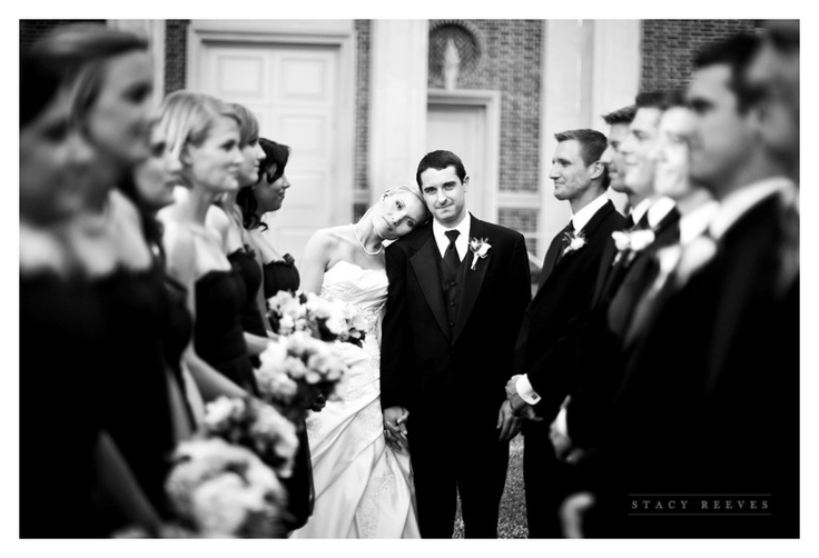 bridal party pose... love this!  Looks so much more cozy then a group of people standing face first in one long line