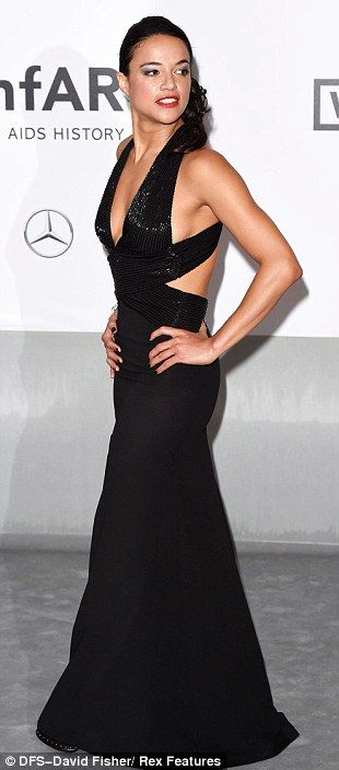 Cannes 2014.  She scrubs up well! Michelle Rodriguez, who has reportedly split from Cara Delevingne, looked incredible in a low cut black dress with cut-out detail