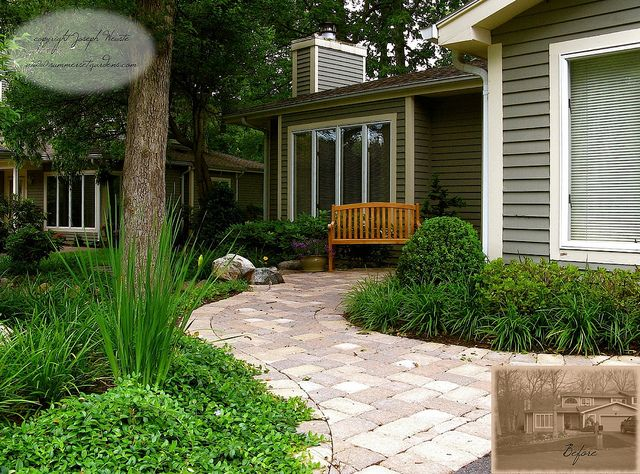 A pretty and generously proportioned walk with shade beds takes the place of lawn