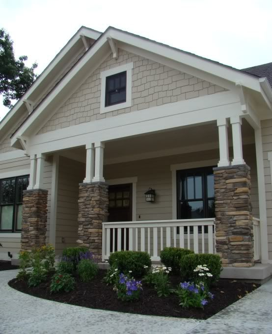 love the rock siding and porch -- want this rock siding with maybe a smokey blue house color
