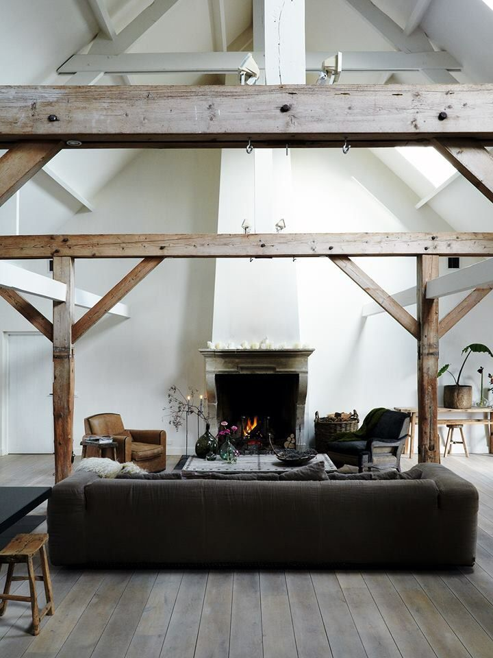 white living room with beams and large grey sofa☆