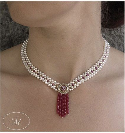 Decadent woven seed pearl necklace with faceted gold beads, antique diamond brooch and ruby tassle.  Perfect for a bride looking for old world elegance on her wedding day. By Marina J Jewelry
