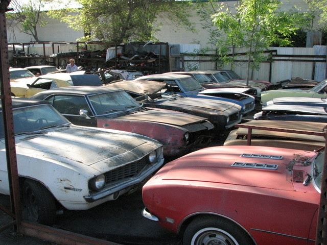Chevrolet Camaros in a yard