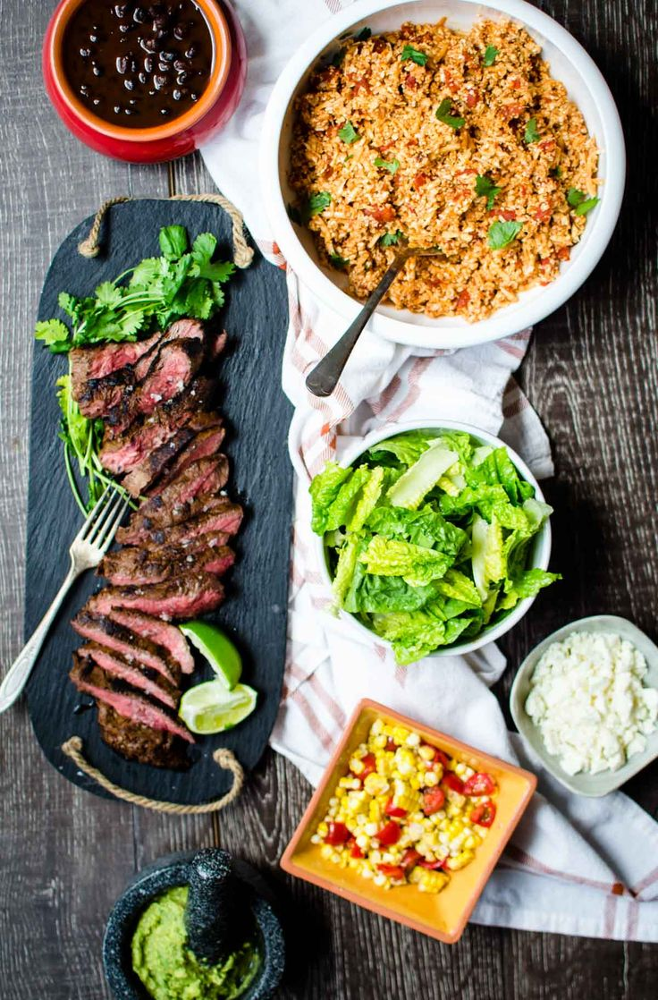 This recipe for flavorful Carne Asada Burrito Bowls is made with tender flat iron steak and a light, healthy Mexican cauliflower rice.