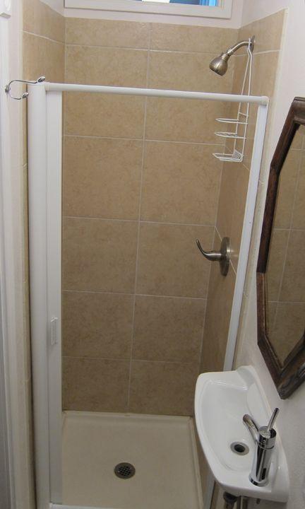 Shower Door With Retractable Storage Built In Squeegee
