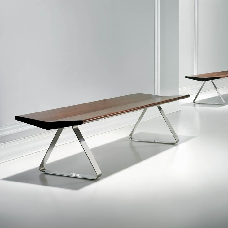 The Fly bench was designed for Bernhardt as part of the Global Edition furniture. The concept for the collection is timelessness; simple, pure and universal design that nonetheless breaks the mold. Fly is available with a solid oak or walnut plank, suspended in mid-air by two stainless-steel triangles. The bench is sculpturally expressive yet structuraly sound. It is clean, iconic, aesthetic -- yet ergonomic. The two sides of the bench gently slope inward for maximum comfort when seated…