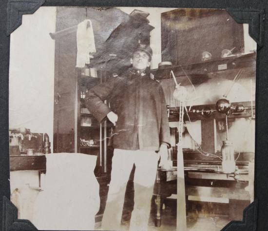 The designer of a revolutionary new X-ray tube, Saÿen in his lab at Ft McPherson, 1898.  His X-ray tube was the first that would automatically regulate its own gas pressure. Notice the X-ray tubes on the shelves. The original photograph is in the museum's Accession File #267872.