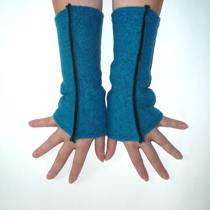 Petrol teal arm cuffs, felted wool with black cotton lining. $26.50, via Etsy.